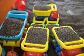 """Kid colourful toys with man made """"sand"""" from cassia tora seed poster"""