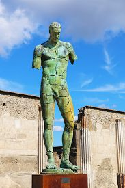 Pompeii, Italy - October 8, 2016: Modern sculpture artwork by the Polish sculptor Igor Mitoraj displayed at the ancient town of Pompeii, Italy