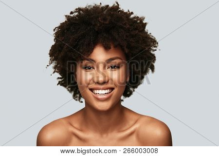 Feeling Beautiful. Attractive Young African Woman Looking At Camera And Smiling While Standing Again