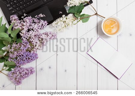 Beautiful Branch Of White And Violet Lilac Flowers With Opened Note-book And Black Opened Laptop, Ly