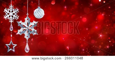 Silver Baubles Hanging In Red Shiny Background