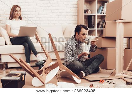 Assemble Furniture. Man Repairing Chair. Man With Furniture Instructions. Furniture Assembler Have W