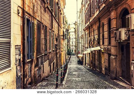 Traditional Narrow Italian Street With A Cafe And No People