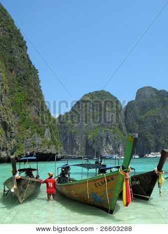 Three traditional Thai boats in the Maya Bay of Phi-Phi island
