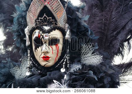 Carnival Black-silver Mask And Costume At The Traditional Festival In Venice, Italy