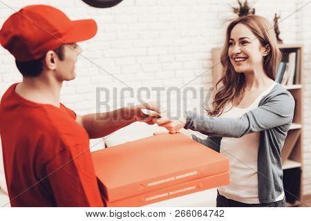 Pizza Delivery. Pizza Deliveryman. Man With Box Is Funny Accessory. White Interior. Deliveryman Arab