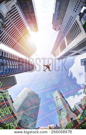 Business Concept With Stock Market Ticker On Modern Skyscrapers In Singapore