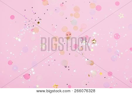 Pink Pastel Festive Background With Confetti And Sparkles. Flat Lay Style.
