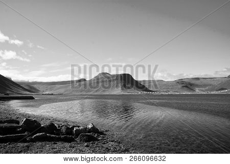Summer Vacation In Isafjordur, Iceland. Hilly Coastline On Sunny Blue Sky. Mountain Landscape Seen F