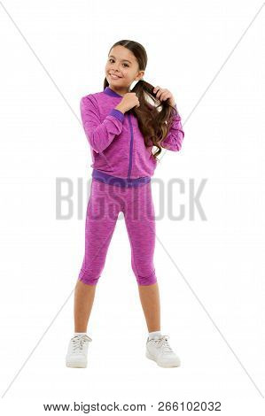 Deal with long hair while exercising. Working out with long hair. Girl cute kid with long ponytails wear sportive costume isolated on white. Sport for girls. Guidance on working out with long hair. poster
