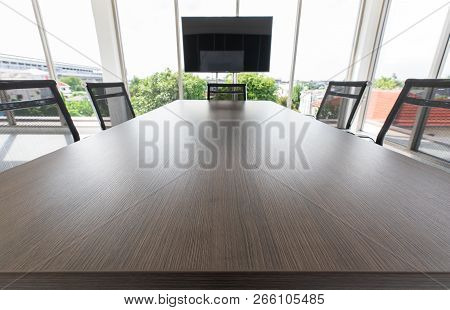 Group Of Black Chairs Around Table In White Conference Room, Modern Meeting Space In New Office, Nob