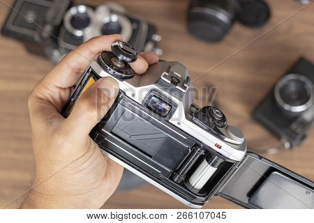 Placing Photographic Roll In A Camera With The Hands