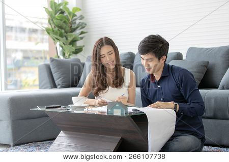 Asian Teenage Couple Is Planning To Build His Future House With His Wife In A Modern Apartment.