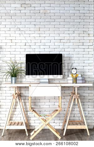 Decoration In Modern Minimal White Office With Computer On Desk And A White Brick Wall Background.