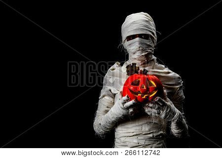 Studio Shot Portrait  Of Young Man In Costume  Dressed As A Halloween  Cosplay Of Scary Mummy Pose L