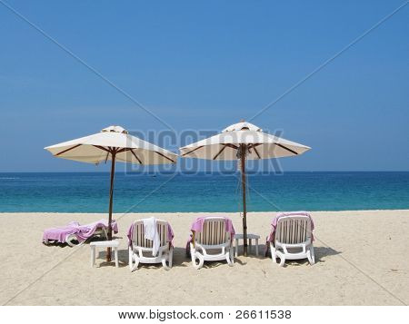 Sun umbrellas and chairs on the Bang Tao beach of Phuket island