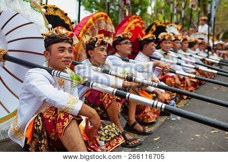 Bali, Indonesia - June 23, 2018: Group Of Young Dancer Men In Ethnic Costumes With Traditional Red,