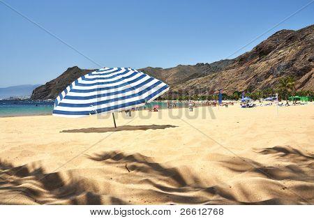 Striped umbrella on the Teresitas beach of Tenerife island. Canaries