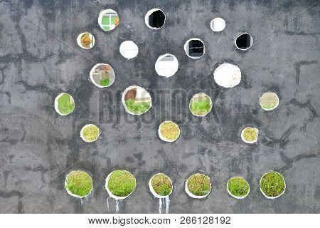 A Wall Concrete Polishing Wall With Many Blowholes And Blur Green Grass Background