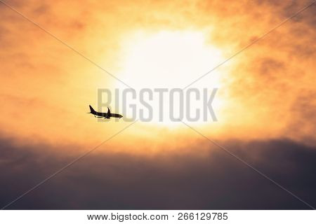 Traveling Airplane Silhouette In Sunset. Traveling Lifestyle Concept. Airplane Travel. Airplane Silh