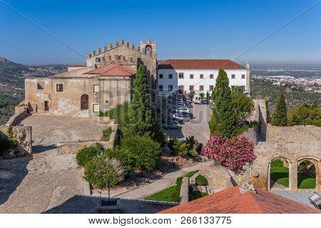 Palmela, Portugal - September 11, 2017: Castelo de Palmela Castle with Historical Hotel of Pousadas de Portugal, Igreja de Santiago Church and Casa Capelo House