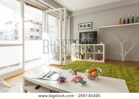 Bright Living Room With Book Shelf And Coffee Table, White Interior Design - Modern Living Space