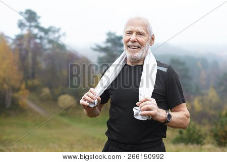 Happy Elderly Caucasian Male With Stubble Choosing Active Lifstyle, Smiling Broadly After Intensive