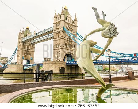 London, United Kingdom - June 09, 2013: Tower Bridge And Girl With A Dolphin, Sculpture By Artist Da