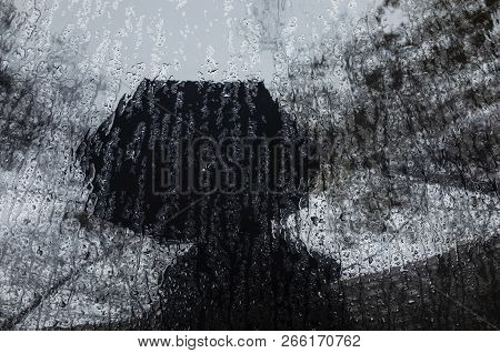 Rainy Weather Reflections. Man With An Umbrella Under Rain. Bad Weather
