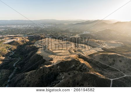 Aerial view of hilltop construction grading near the Porter Ranch community in the San Fernando Valley area of Los Angeles, California.