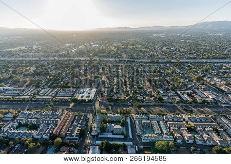 Aerial sunset view towards Sepulveda Blvd and the 405 freeway in the North Hills area of the San Fernando Valley in the City of Los Angeles, California.