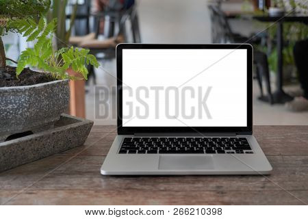 Laptop With Blank Screen On Table. Conceptual Workspace, Laptop Computer With Blank White Screen On
