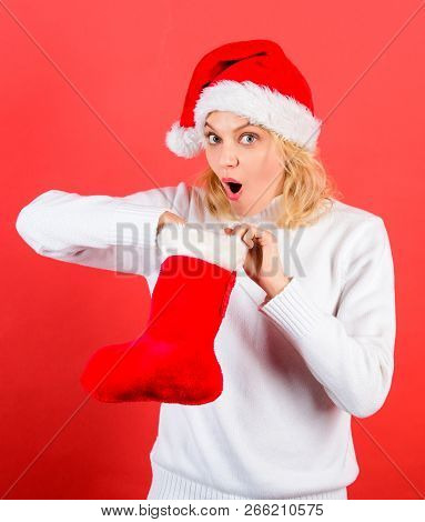 Check Contents Of Christmas Stocking What She Received. Christmas Stocking Concept. Girl Cheerful Fa