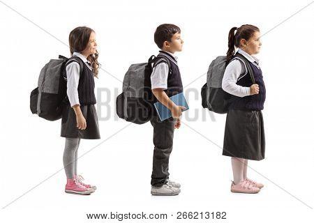 Full length profile shot of schoolchildren waiting in line isolated on white background poster