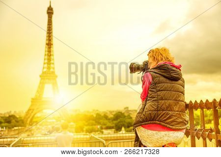 Photographer On Place Du Trocadero Of Tour Eiffel At Sunset. Traveler Woman In Paris, France, Europe