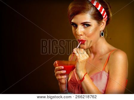 Retro woman with music vinyl record. Pin up girl drink drink through straw martini cocktail. Girl pin-up retro style wearing red dress on dark background. Illegal alcohol at party.