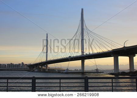Western Rapid Diameter Highway and Cable-Stayed Bridge Over Neva River in Saint Petersburg, Russia. Newly Built Modern City Western High Speed Diameter (WHSD) Toll Motorway View with Empty Sky poster