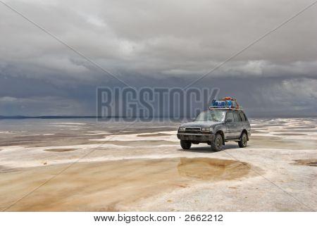 Truck In The Salt Lake Salar De Uyuni, Bolivia