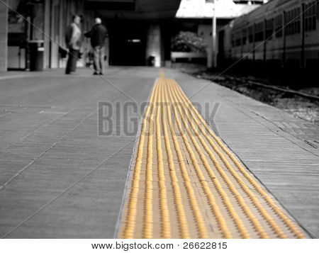 Perspective yellow tactile strip for cane or foot of blind person