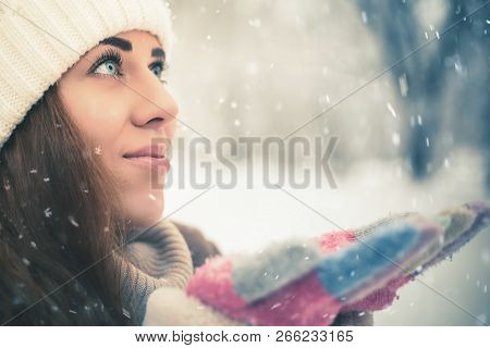 Happy Woman At Cold Snowy Winter At New York Park