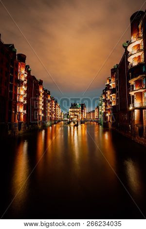 Hamburg, Germany. View Of Wandrahmsfleet At Dusk Illumination Light With Reflection In The Water. Lo