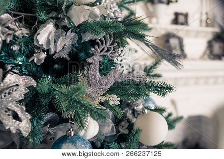 Christmas Tree With Blue And White Toys In The Interior.christmas Card With White And Blue Decor.vin