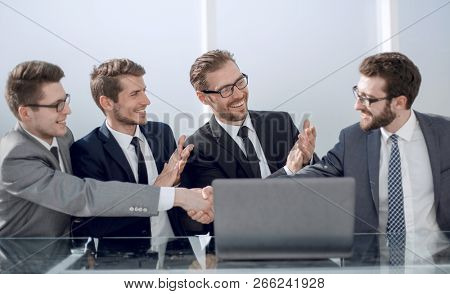 close up. handshake employees at a working meeting