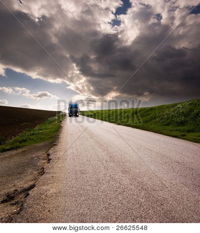 landscape for truck on road and stormy sky poster