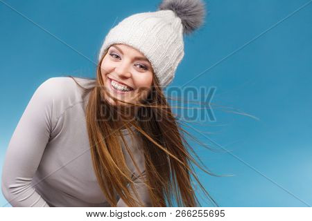 Attractive Woman In Winter Wool Cap And Gray Sports Thermolinen Underwear For Skiing Training Studio