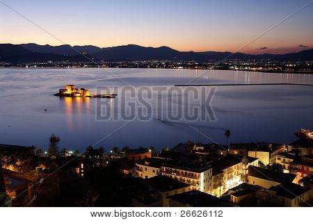 aerial view by night of bay Nauplia at twilight with the castle of Bourtzi on the small island