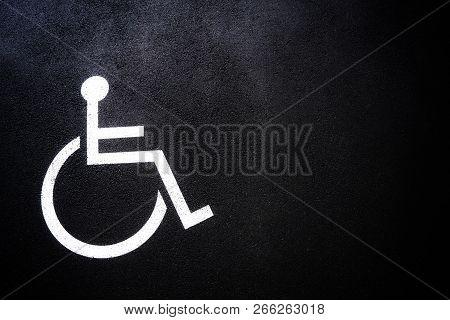Disabled People Icon Or Handicap Symbol On Parking Space.sign Design On Urban Asphalt Road.wheel Cha
