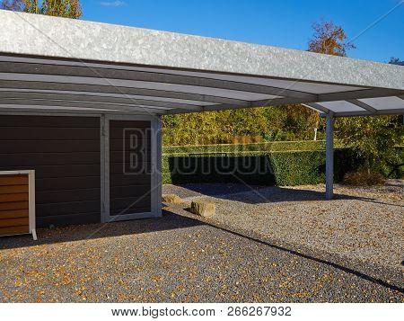 Modern Carport Car Garage Parking Made Of Silver Metal And Glass