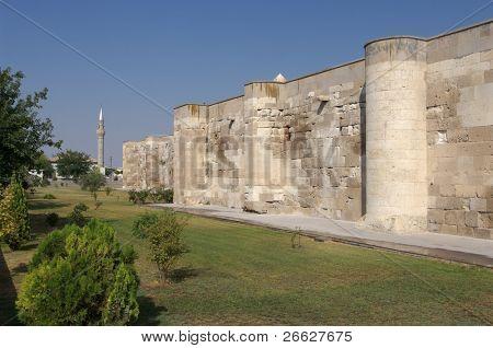 surrounding wall of the Sultanhani caravansary on the Silk Road and minaret, Turkey