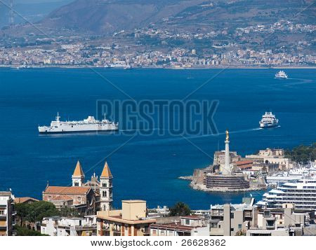 view of the strait and Messina's port, Calabria coastline in the background - Italy